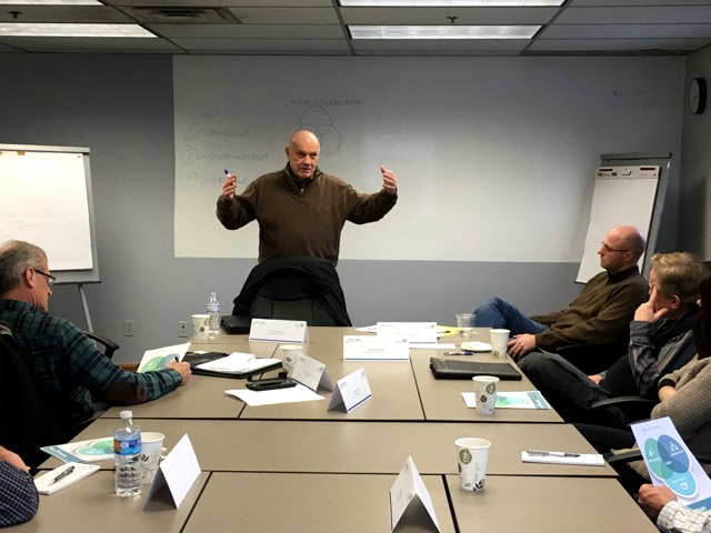 Jack Mencini conducting a group coaching session at Maximum Value Partners